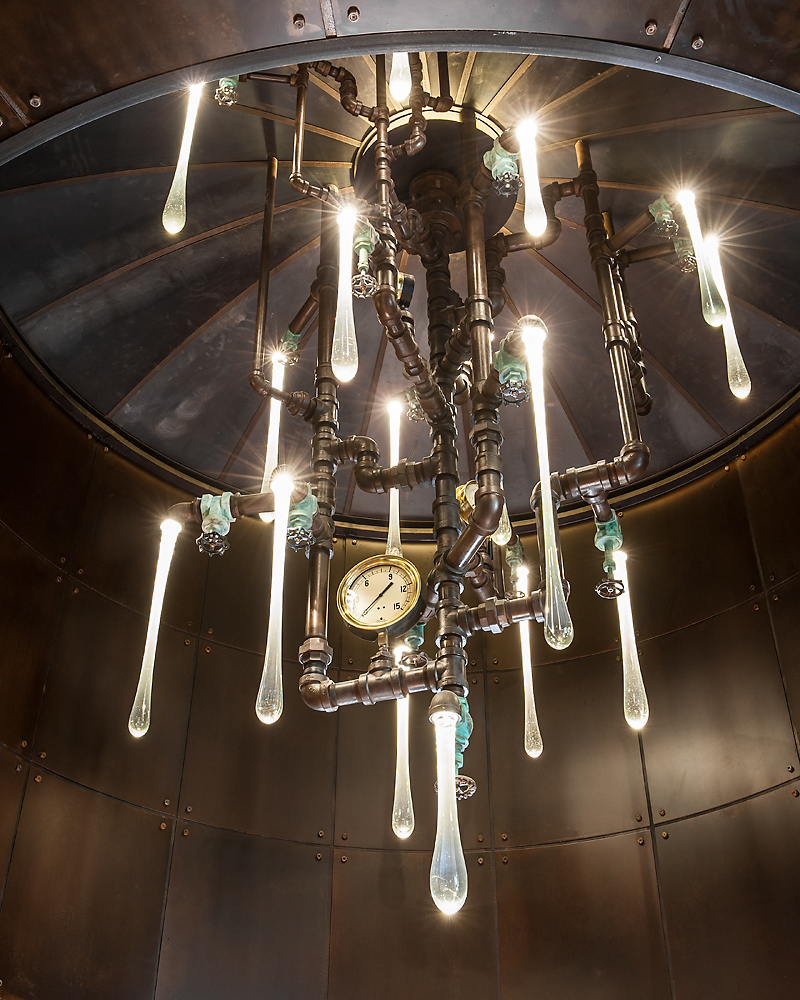 Original liquid light glass custom chandelier installation in a private residence in Arizona